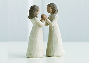 Two statues of women holding hands