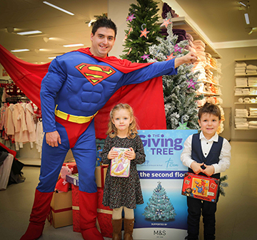 Superman aka Rick Gordon took some time out from saving the world to help four year old Olivia Blair and three year old Ksawier Pal launch the 2017 Giving Tree, a cross-community initiative run by Belfast Central Mission and the Society of St Vincent De Paul and supported by Marks and Spencer to help local children in need have a happier Christmas.  The Giving Tree, which will be in Marks and Spencer Donegall Place Belfast, from 26 November to 9 December, gives members of the public an opportunity to donate a toy or gift for a local child with the gifts being divided equally between SVP and BCM before being distributed to families in the weeks leading up to Christmas.