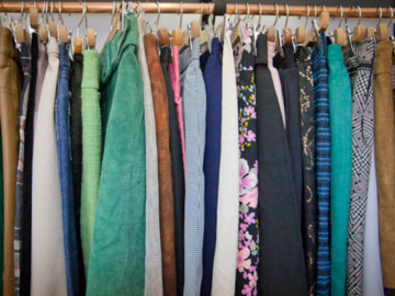 Clothes hanging up on a rack
