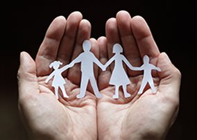 family paper cut out in hands